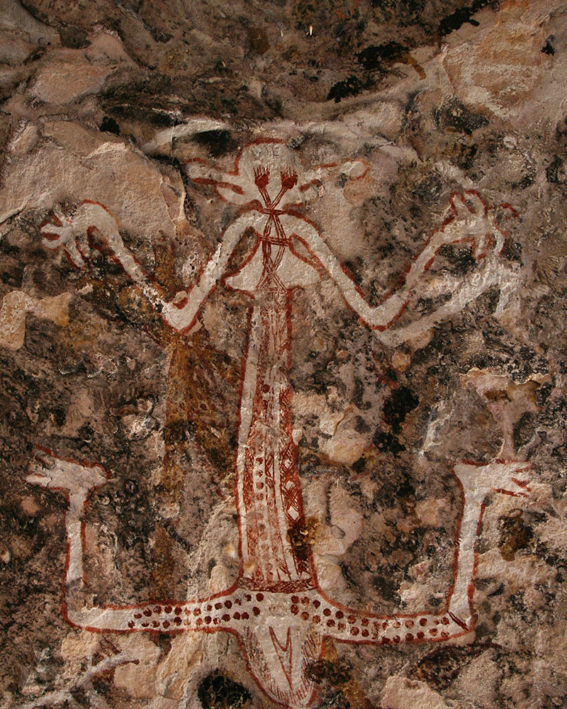The wife of 'lightning man', who clashes basalt axes together on his elbows and knees