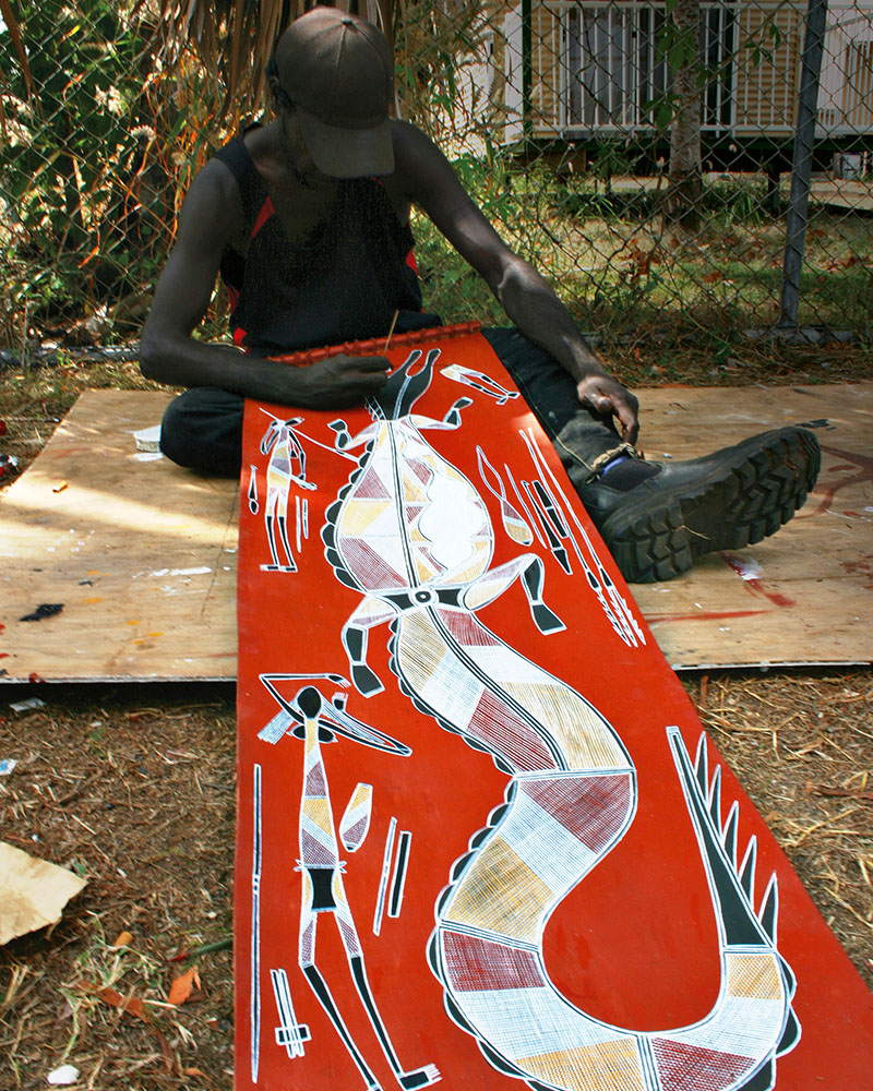 An artist at the excellent Injalaj art centre sells traditional art